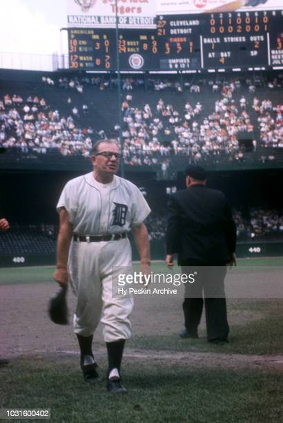Manager Jimmy Dykes of the Detroit Tigers walks back to the dugout after arguing a play with third base umpire Bill Summers during an MLB game on...