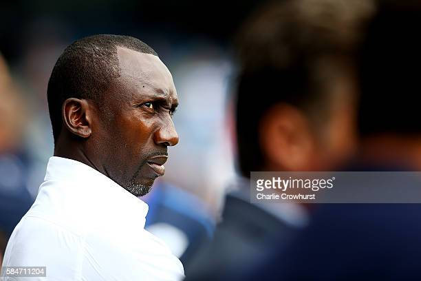 QPR manager Jimmy Floyd Hasselbaink keeps an eye on the warm up during the PreSeason friendly match between Queens Park Rangers and Watford at Loftus...