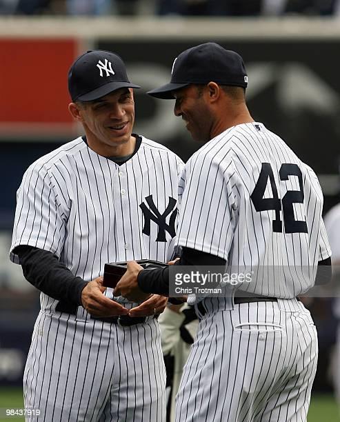 Manager Joe Girardi hands Mariano Rivera of the New York Yankees his World Series ring for being a member of the 2009 New York Yankees Worlder Series...
