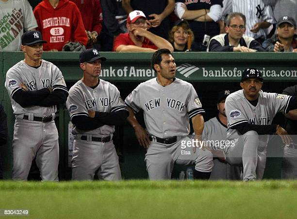 Manager Joe Girardi, Johnny Damon and the rest of the New York Yankees look on in the 10th inning against the Boston Red Sox on September 28, 2008...