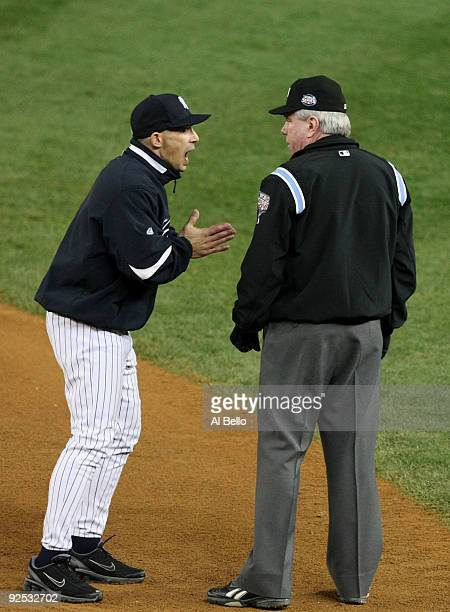 Manager Joe Girardi of the New York Yankees argues after a call with umpire Brian Gorman in the seventh inning against the Philadelphia Phillies in...