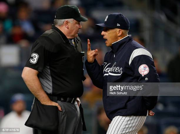 Manager Joe Girardi of the New York Yankees argues with home plate umpire Bill Welke after being thrown out of the game in the seventh inning against...