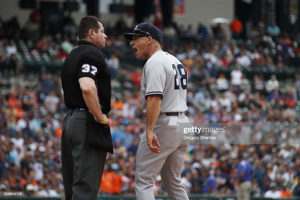 Manager Joe Girardi #28 of the New York Yankees argues with umpire Carlos Torres in the sixth inning while playing the Detroit Tigers at Comerica Park on August 24, 2017 in Detroit, Michigan.