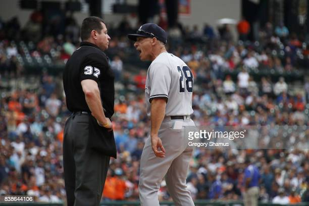 Manager Joe Girardi of the New York Yankees argues with umpire Carlos Torres in the sixth inning while playing the Detroit Tigers at Comerica Park on...