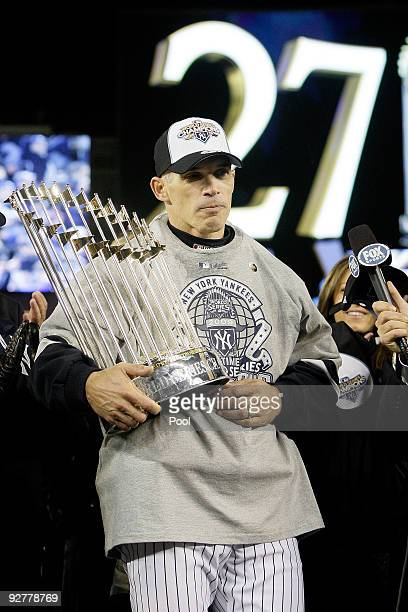 Manager Joe Girardi of the New York Yankees celebrate after their 73 win against the Philadelphia Phillies in Game Six of the 2009 MLB World Series...