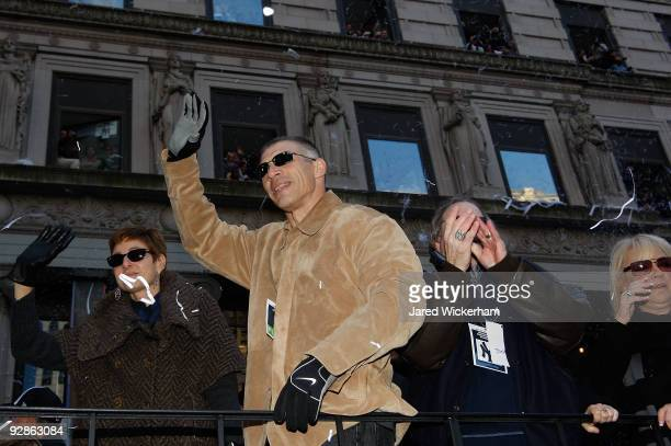 Manager Joe Girardi of the New York Yankees celebrates on a float during the New York Yankees World Series Victory Parade on November 6 2009 in New...