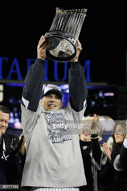 Manager Joe Girardi of the New York Yankees celebrates with the trophy after their 73 win against the Philadelphia Phillies in Game Six of the 2009...