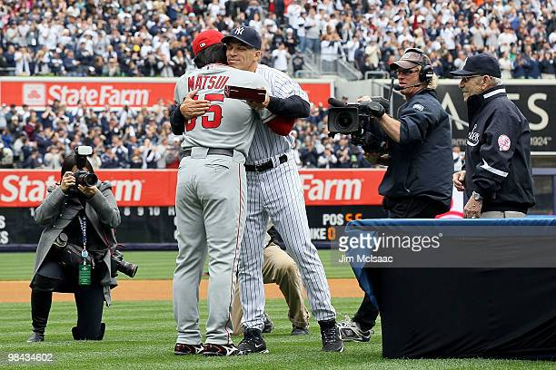 Manager Joe Girardi of the New York Yankees greets Hideki Matsui of the Los Angeles Angels of Anaheim after Matsui received his 2009 World Series...