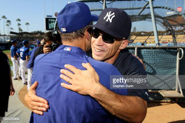 Manager Joe Girardi of the New York Yankees hugs manager Joe Torre of the Los Angeles Dodgers before their game on June 25 2010 at Dodger Stadium in...