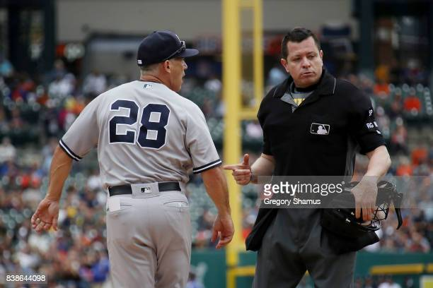 Manager Joe Girardi of the New York Yankees is ejected from the game by umpire Carlos Torres in the sixth inning while playing the Detroit Tigers at...