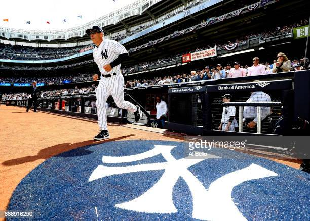 Manager Joe Girardi of the New York Yankees is introduced before the game against the Tampa Bay Rays during the New York Yankees home Opening game at...