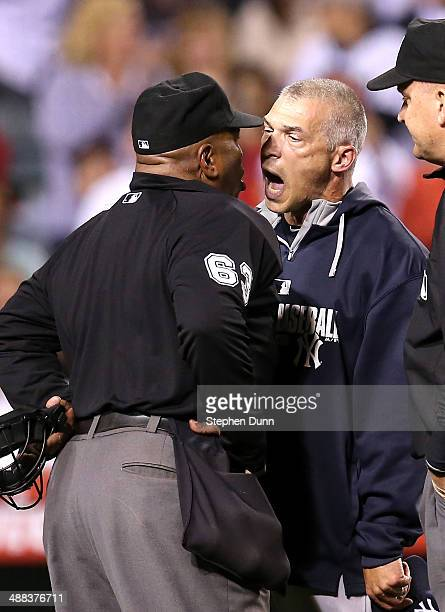 Manager Joe Girardi of the New York Yankees shouts at home plate umpire Laz Diaz after Girardi was ejected for arguing a strike call in the eighth...