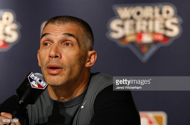 Manager Joe Girardi of the New York Yankees talks at a press conference after World Series workouts on October 27, 2009 at Yankee Stadium in the...