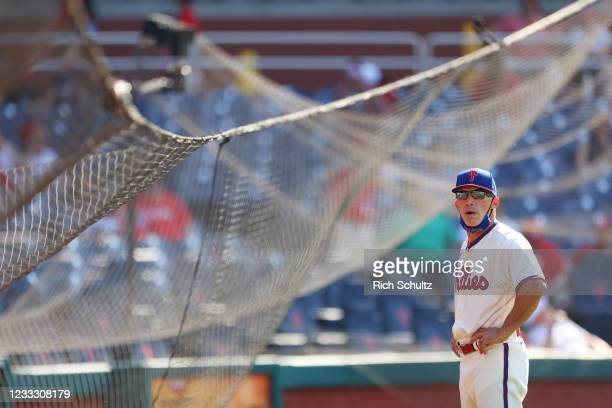 Manager Joe Girardi of the Philadelphia Phillies looks on after the protective netting from home plate to first base collapsed during the eighth...