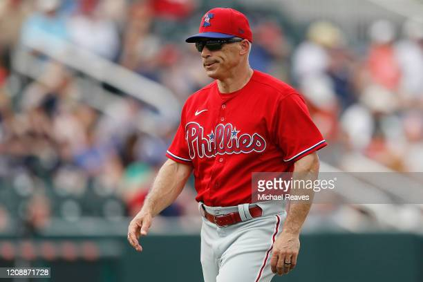 Manager Joe Girardi of the Philadelphia Phillies looks on against the Minnesota Twins during the fifth inning of a Grapefruit League spring training...