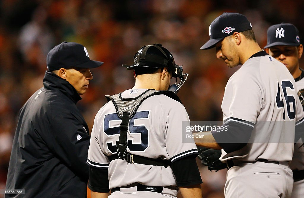 Manager Joe Girardi pulls Andy Pettitte #46 of the New York Yankees in the eighth inning during Game Two of the American League Division Series against the Baltimore Orioles at Oriole Park at Camden Yards on October 8, 2012 in Baltimore, Maryland.