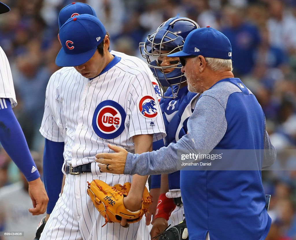 Manager Joe Maddon #70 0f the Chicago Cubs goes to the mound to talk with Koji Uehara #19 in the 8th inning against the San Diego Padres at Wrigley Field on June 21, 2017 in Chicago, Illinois.