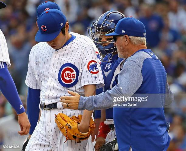 Manager Joe Maddon 0f the Chicago Cubs goes to the mound to talk with Koji Uehara in the 8th inning against the San Diego Padres at Wrigley Field on...