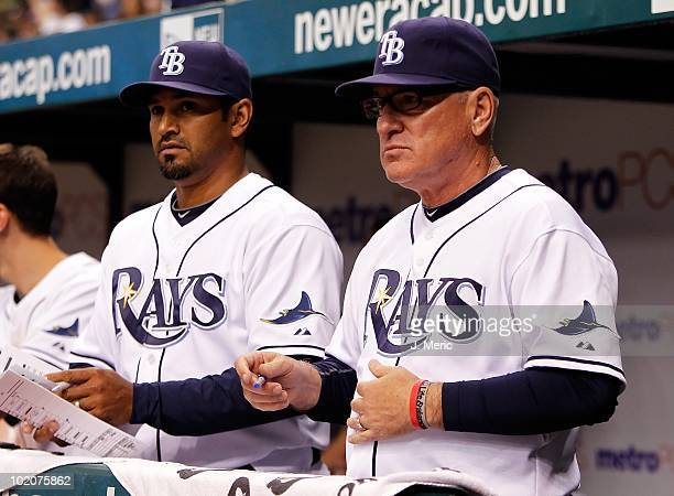 Manager Joe Maddon and bench coach Dave Martinez of the Tampa Bay Rays watch their team against the Florida Marlins during the game at Tropicana...