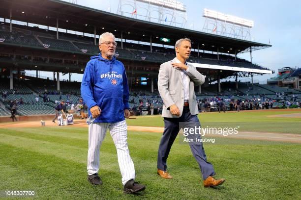 Manager Joe Maddon and General Manager Jed Hoyer of the Chicago Cubs walk on the field ahead of the National League Wild Card game against the...