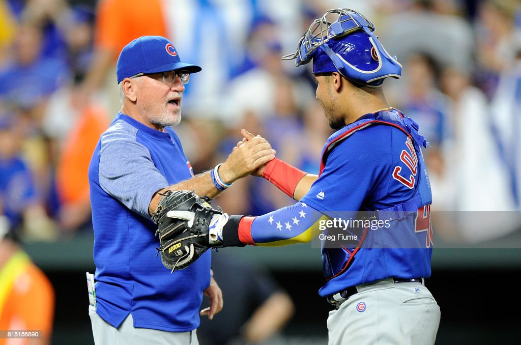 Manager Joe Maddon #70 and Willson Contreras #40 of the Chicago Cubs celebrate after a 10-3 victory against the Baltimore Orioles at Oriole Park at Camden Yards on July 15, 2017 in Baltimore, Maryland.