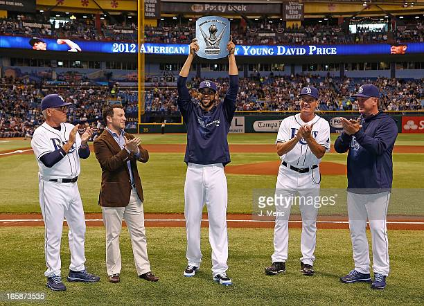 Manager Joe Maddon, General Manager Andrew Friedman, Pitcher David Price, Pitching coach Jim Hickey and Bullpen coach Stan Boroski of the Tampa Bay...