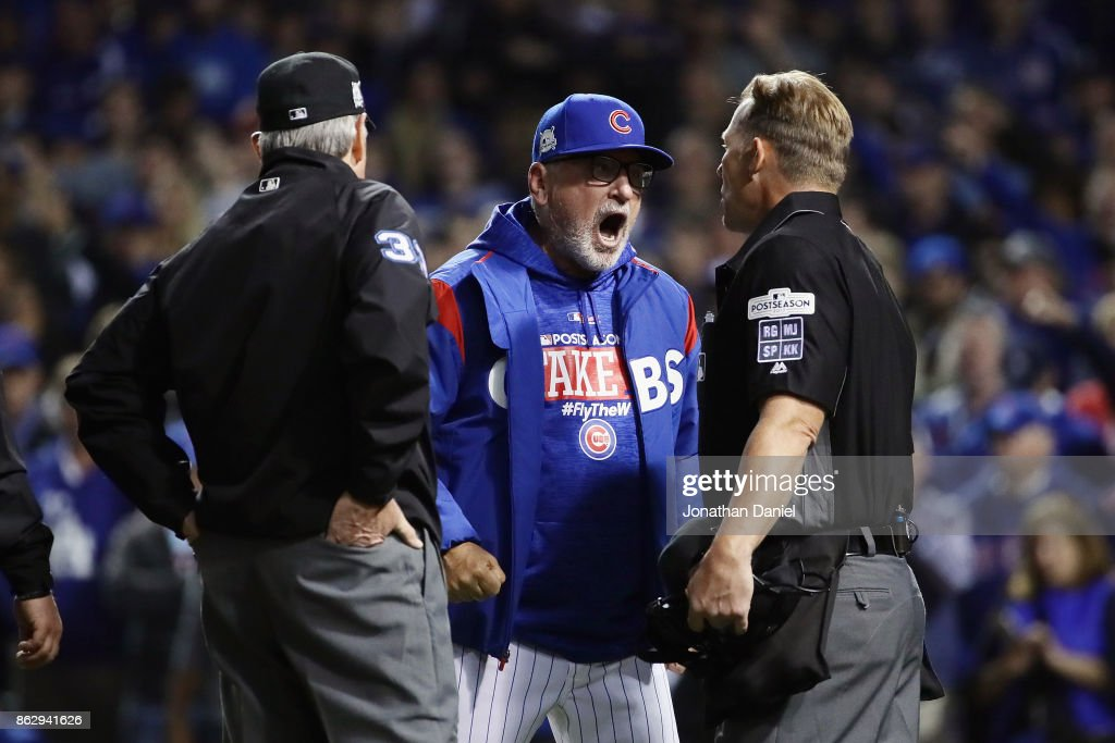 Manager Joe Maddon of the Chicago Cubs argues an overturned call with umpires and is ejected in the eighth inning during game four of the National League Championship Series between the Los Angeles Dodgers and the Chicago Cubs at Wrigley Field on October 18, 2017 in Chicago, Illinois.