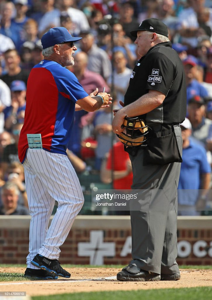 Manager Joe Maddon #70 of the Chicago Cubs argues with home plate umpire Bill Miller #26 after being ejected in the 7th inning during a game against the Washington Nationals at Wrigley Field on August 10, 2018 in Chicago, Illinois. The Cubs defeated the Nationals 3-2.