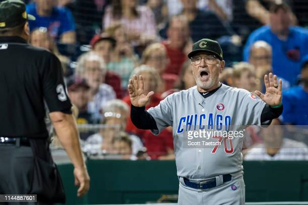 Manager Joe Maddon of the Chicago Cubs argues with umpire Sam Holbrook during the ninth inning against the Washington Nationals at Nationals Park on...