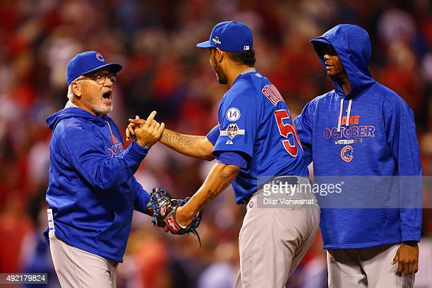 Manager Joe Maddon of the Chicago Cubs celebrates with Hector Rondon of the Chicago Cubs after the Chicago Cubs defeat the St Louis Cardinals in game...