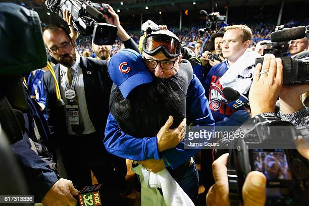 Manager Joe Maddon of the Chicago Cubs celebrates with his wife Jaye Sousoures after defeating the Los Angeles Dodgers 50 in game six of the National...
