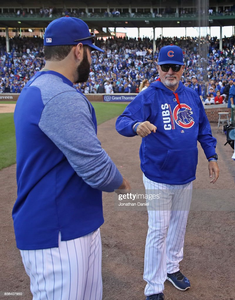 Manager Joe Maddon #70 of the Chicago Cubs (R) congraulates Alex Avila #13 after the last regular season game against the Cincinnati Reds at Wrigley Field on October 1, 2017 in Chicago, Illinois. The Reds defeated the Cubs 3-1.