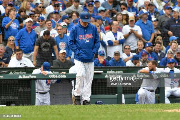 Manager Joe Maddon of the Chicago Cubs heads to the mound during the game against the Milwaukee Brewers on Monday October 1 2018 at Wrigley Field in...