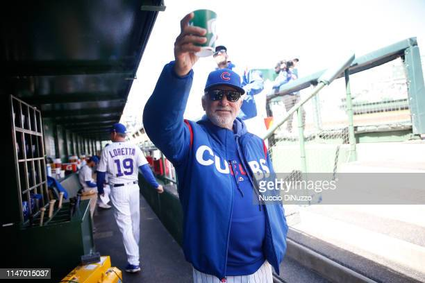 Manager Joe Maddon of the Chicago Cubs in the dugout before the game against the St Louis Cardinals at Wrigley Field on May 04 2019 in Chicago...