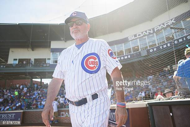 Manager Joe Maddon of the Chicago Cubs looks on before the game against the Los Angeles Angels during a spring training game at Sloan Park on March 4...