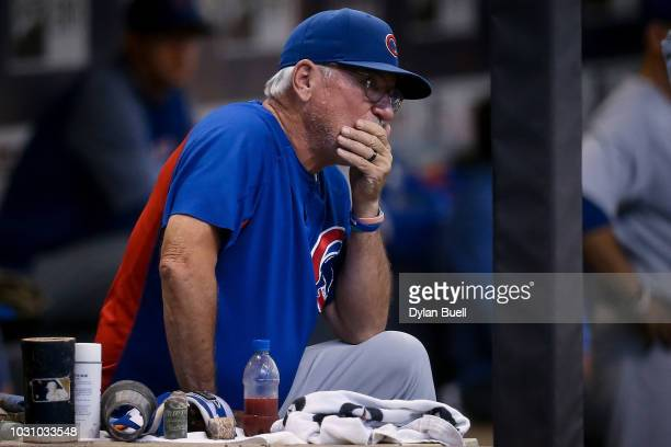 Manager Joe Maddon of the Chicago Cubs looks on from the dugout in the second inning against the Milwaukee Brewers at Miller Park on September 3 2018...