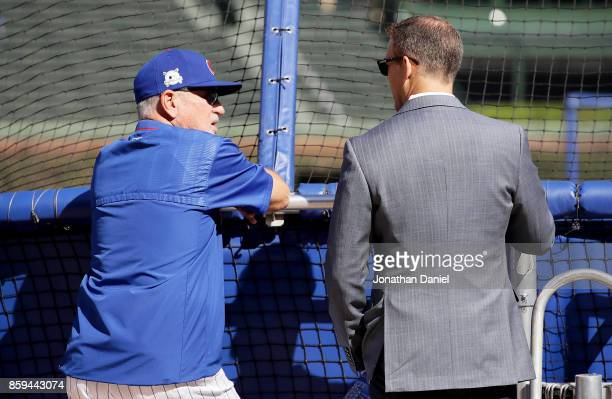 Manager Joe Maddon of the Chicago Cubs meets with general manager Theo Epstein before game three of the National League Division Series against the...