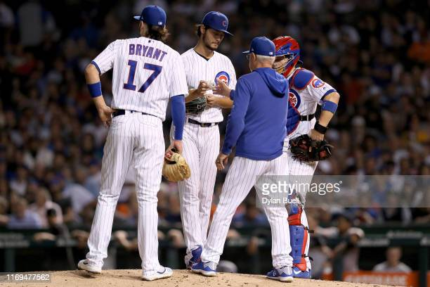 Manager Joe Maddon of the Chicago Cubs relieves Yu Darvish in the sixth inning against the San Francisco Giants at Wrigley Field on August 21 2019 in...