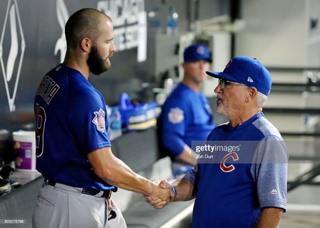 Manager Joe Maddon #70 of the Chicago Cubs (R) shakes hands with Jake Arrieta #49 after taking him out of the game against the Chicago White Sox during the seventh inning at Guaranteed Rate Field on July 26, 2017 in Chicago, Illinois.