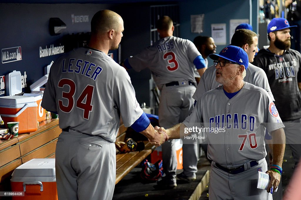 Manager Joe Maddon #70 of the Chicago Cubs shakes hands with Jon Lester #34 of the Chicago Cubs in the dugout against the Los Angeles Dodgers in game five of the National League Division Series at Dodger Stadium on October 20, 2016 in Los Angeles, California.
