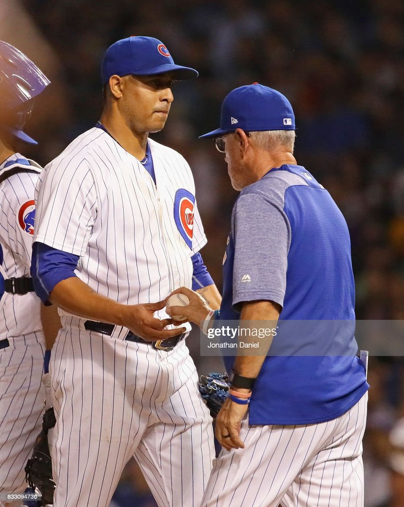 Manager Joe Maddon #70 of the Chicago Cubs takes Hector Rondon #56 out of the game in the 7th ining after Rondon gave up a two run home run at Wrigley Field on August 16, 2017 in Chicago, Illinois.