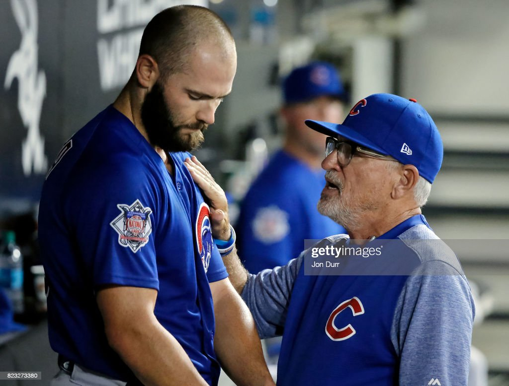 Manager Joe Maddon #70 of the Chicago Cubs (R) talks with Jake Arrieta #49 after taking him out of the game against the Chicago White Sox during the seventh inning at Guaranteed Rate Field on July 26, 2017 in Chicago, Illinois.