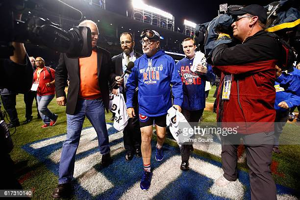 Manager Joe Maddon of the Chicago Cubs walks off the field after defeating the Los Angeles Dodgers 50 in game six of the National League Championship...