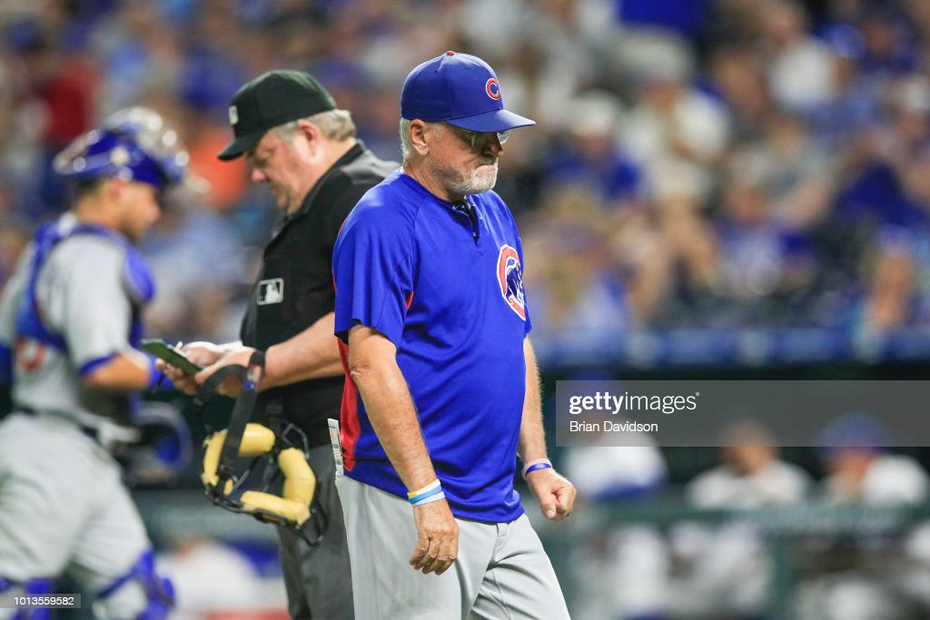 Manager Joe Maddon #70 of the Chicago Cubs walks off the field during the seventh inning against the Kansas City Royals at Kauffman Stadium on August 8, 2018 in Kansas City, Missouri.