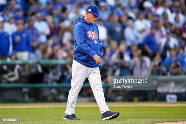 Manager Joe Maddon of the Chicago Cubs walks to the mound in the sixth inning against the Washington Nationals during game three of the National...