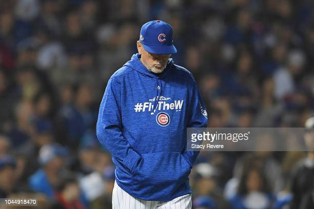 Manager Joe Maddon of the Chicago Cubs walks to the pitcher's mound in the eighth inning against the Colorado Rockies during the National League Wild...