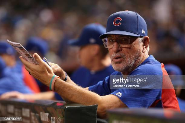 Manager Joe Maddon of the Chicago Cubs watches from the dugout during the first inning of the MLB game against the Arizona Diamondbacks at Chase...