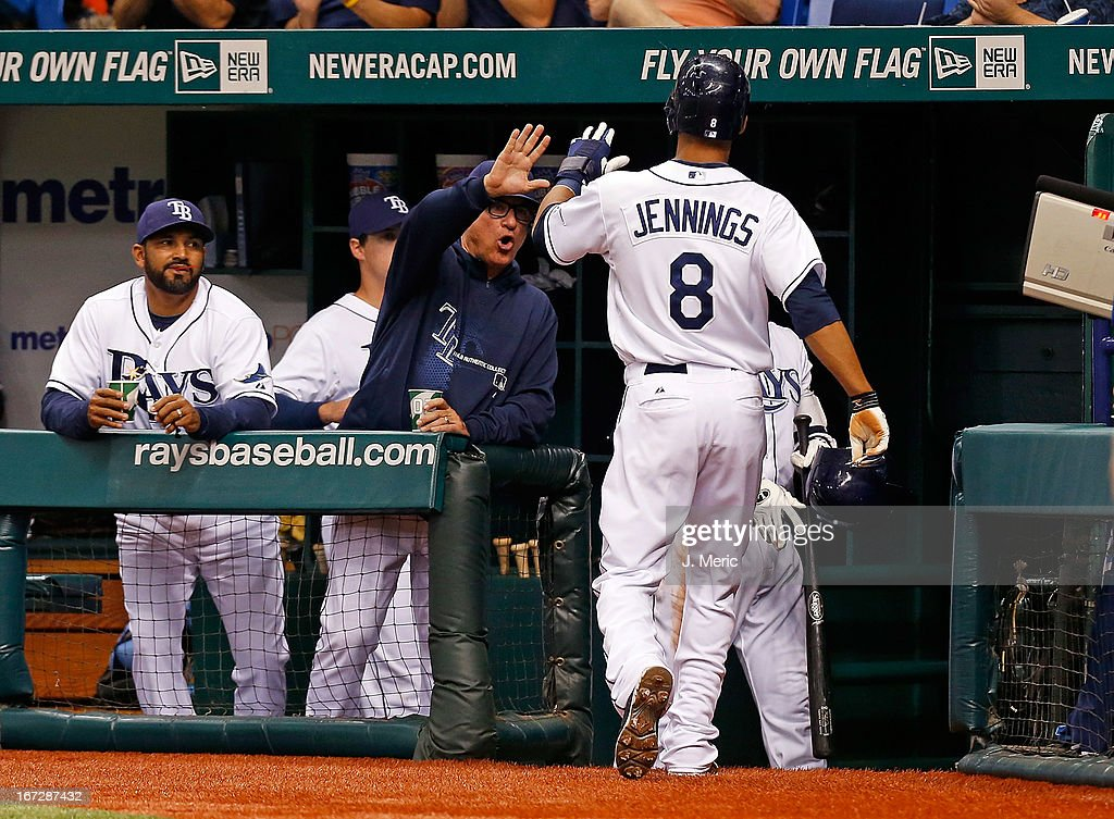 Manager Joe Maddon #70 of the Tampa Bay Rays congratulates Desmond Jennings #8 after he scored against the New York Yankees in the first inning during the game at Tropicana Field on April 23, 2013 in St. Petersburg, Florida.