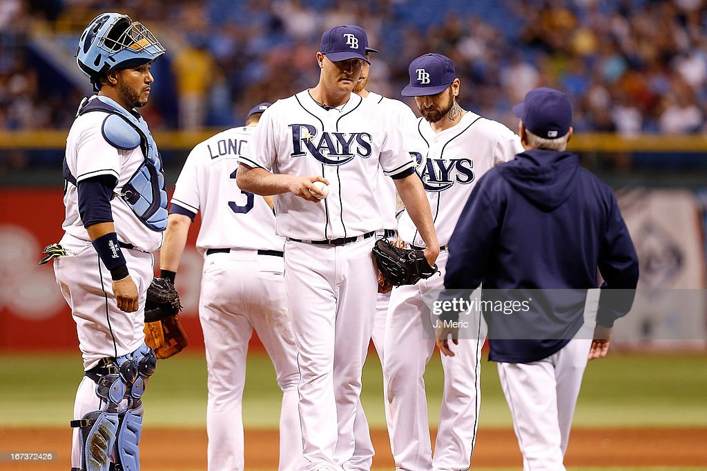 Manager Joe Maddon #70 of the Tampa Bay Rays takes out pitcher Alex Cobb #53 in the ninth inning against the New York Yankees during the game at Tropicana Field on April 24, 2013 in St. Petersburg, Florida.