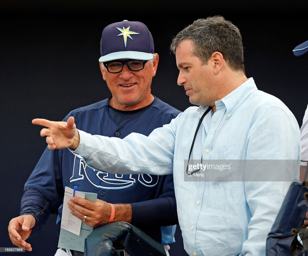 Manager Joe Maddon #70 of the Tampa Bay Rays talks with principal owner Stuart Sternberg just before the start of the Grapefruit League spring training game against the Minnesota Twins at the Charlotte Sports Complex on March 11, 2013 in Port Charlotte, Florida.
